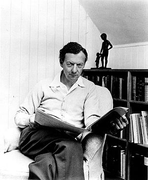Britten reading a newspaper