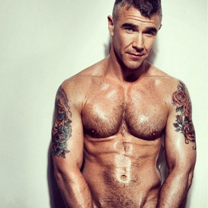 Massow shirtless with tattoos