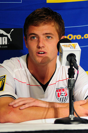 Robbie Rogers speaking to a microphone