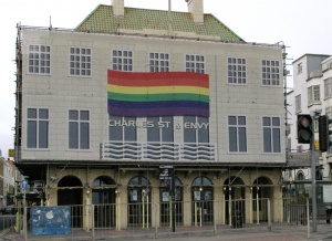 the front of the building, with a very large rainbow flag symbol
